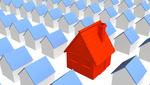 Casas en minuatura azules entre las que destaca una roja